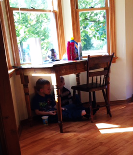 boys-under-table